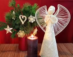 burning candle and ornaments stock photo