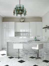 kitchen black and white granite with white cabinets white