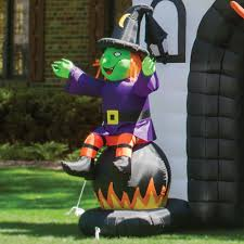 Inflatable Halloween Archway The Inflatable Howling Haunted House Hammacher Schlemmer