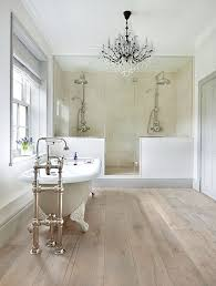 bathroom floor and shower tile ideas chandelier adds to the appeal of this bathroom