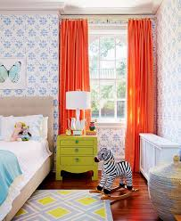 kids bedroom with wallpaper and orange curtains decorating with