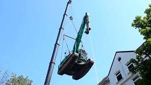 excavator flying through the air spectacular action with crane