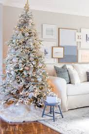 Gold White Christmas Tree A Snowy Flocked Christmas Tree A Burst Of Beautiful