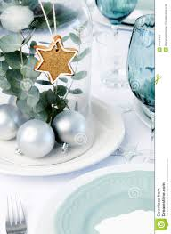 blue christmas dinner table setting with glass dome centerpiece