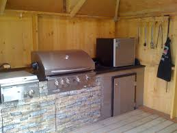 Here s a outdoor kitchen inside a three sided gazebo with a