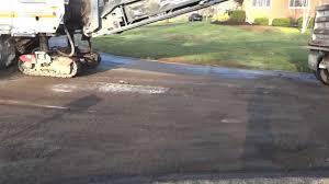 Asphalt Milling Or Grinding Asphalt Surface From A Concrete Road In