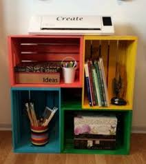 create a bookshelf by stacking old wooden crates achieve