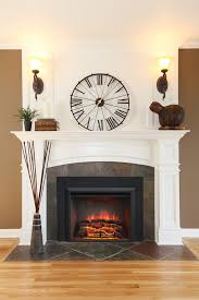 living room interesting wall clock and fireplace inserts with