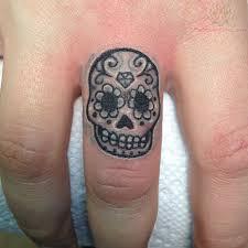 sugar skull ring on middle finger