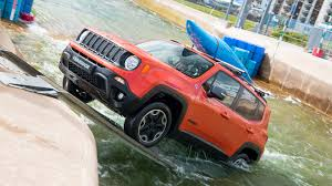 white jeep renegade jeep renegade tackles an olympic white water rafting course
