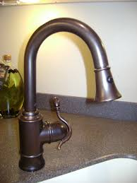 bronze kitchen faucet with stainless sink