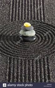 japanese zen garden with stone in black sand stock photo royalty