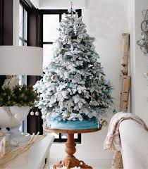 flocked tree a wintry look of your decoration