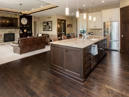 the kitchen island acts as a beautiful transition from kitchen to
