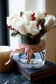 Homemade Christmas Floral Table Decorations by Best 25 Christmas Flower Arrangements Ideas On Pinterest