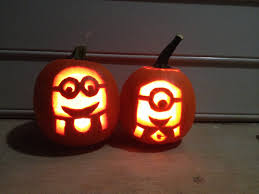 minion pumpkin carvings from despicable me making the one on