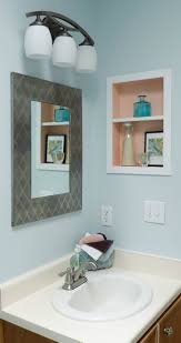 mirror frame ideas rectangle grey mirror frames added by 3 white wall light on blue