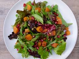 butternut squash salad with pomegranates and toasted pumpkin seeds