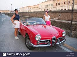 alfa romeo classic alfa romeo spider red cabrio 2 two girls woman petty coat