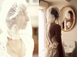 chic bride wears ivory sleeved lace wedding dress and traditional