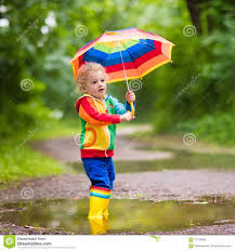 child playing in the rain under umbrella stock photo image 91732483