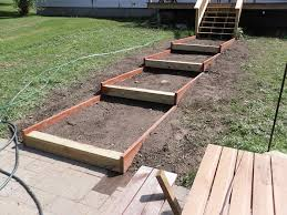 Building Stone Patio by Building Steps On A Slope