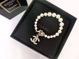 gold bracelet with pearl charm images Authentic chanel 2015 pearl bracelet crystal 2 tone cc gold charm jpg