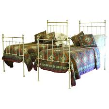 matching pair of victorian brass and cast iron single twin beds
