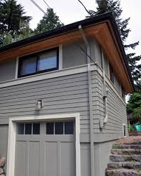 the vented cedar soffits replace the painted plywood