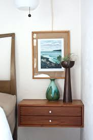 a fantastic solution for the space above a bedside table a custom