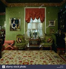 red festoon blind in eighties livingroom with green wallpaper and