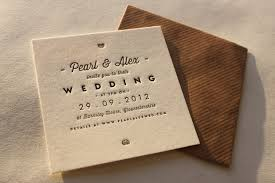 letterpress stationery wording here with signpost to wedding website