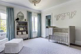 gray and blue nursery features large cursive initials over a