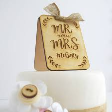 personalised wooden wedding cake topper by just toppers