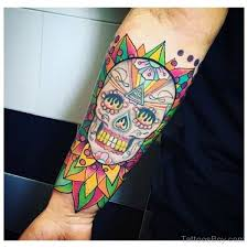 colored skull on wrist designs pictures
