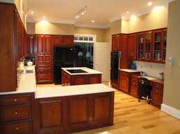 interior of kitchen hickory floors cherry cabinets black appliances and light floor