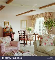 Pink Living Room by Pink Floral Cushions On Pink Armchair And Pale Green Sofa In