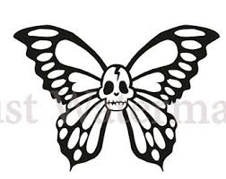 skull with butterfly etsy