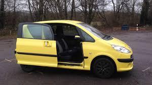 peugeot yellow peugeot 1007 door open and close youtube