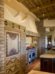southwestern style homes in kitchen with brick wall accents and