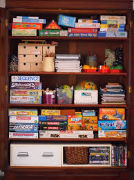board game storage cabinet board game and puzzle storage board games toys pinterest