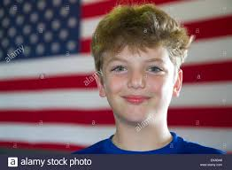 A American Flag Pictures Ten Year Old American Boy Standing In Front Of An American Flag In