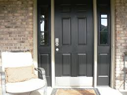 exterior grey wooden six panel entry door with double side light