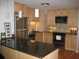 maple cabinets black granite countertop subway tile