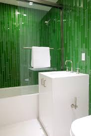 modern bathroom with vibrant green tiles this glass enclosed