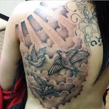 collection of 25 sun with clouds tattoos on lower back