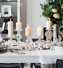 dining room christmas table decorations in front of fireplace with