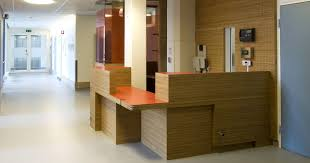 Hospital Reception Desk Medical Design With Perforated Back Wall Cladding And Reception