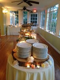 small buffet table ls like the round table at the end for plates decorated with some