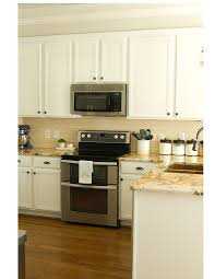 how to remove polyurethane from kitchen cabinets how i painted our kitchen cabinets